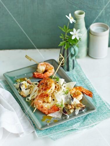 Waldorf salad with fennel and prawn skewers