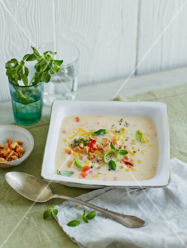 Mexican corn soup with a peanut and chilli topping