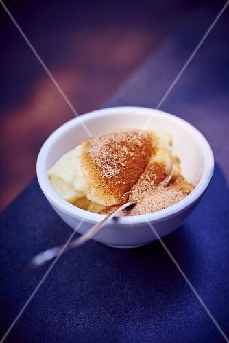 Semolina pudding with cinnamon and sugar