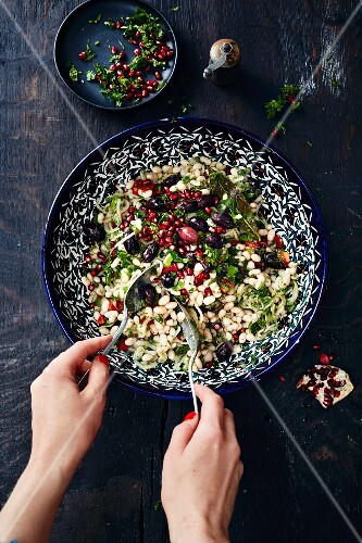 White bean salad, pomegranate seeds, olives and mint (Turkey)
