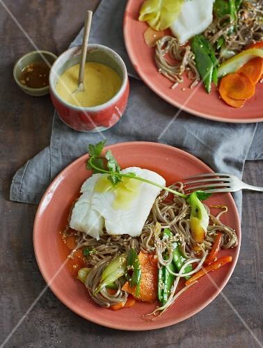 Steamed cod with soba noodles, vegetables and sesame seeds