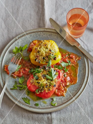 Peppers with a bulgur and olive filling on tomato sauce