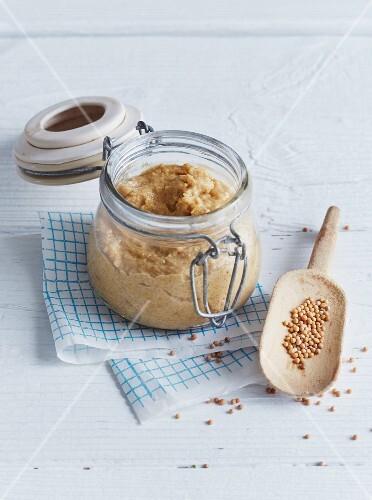 Homemade honey mustard in a flip-top jar