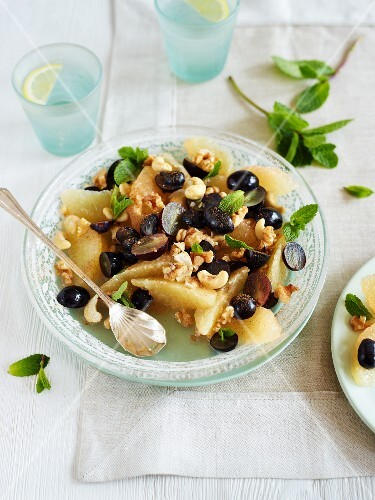 Grapefruit salad with grapes, nuts and mint