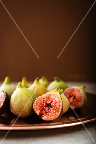Fresh figs on a brown plate