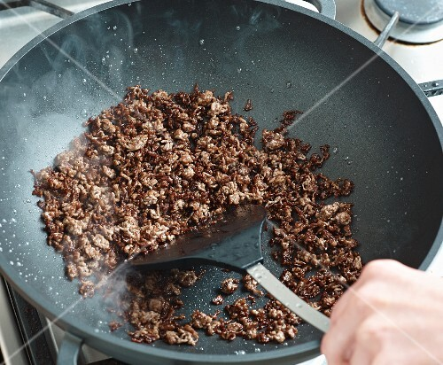 Beef being fried in a wok