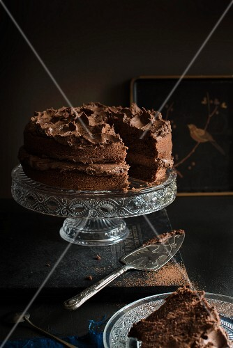 Chocolate cake on a cake stand (sliced)