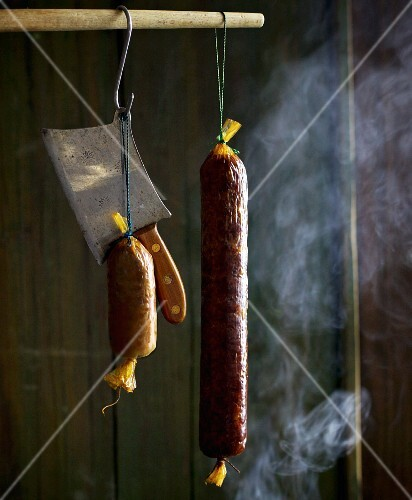 Sausages in a smoking chamber