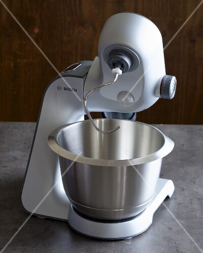 A food processor with a mixing bowl and dough hooks
