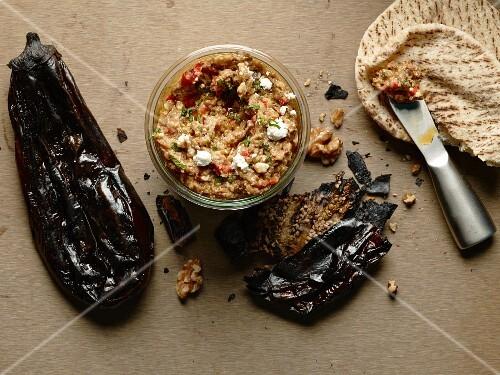Melitzanosalata (Greek aubergine dip) with feta cheese, peppers and walnuts