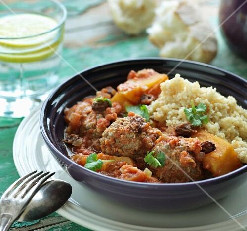 Lamb meatballs in a spicy sauce with couscous