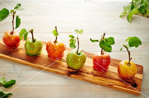Rustic toffee apples on a wooden board