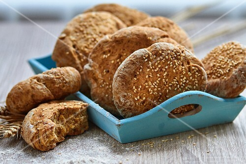 Sesame seed rolls on a wooden board