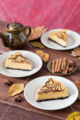 Three slices of pumpkin cheesecake with chocolate