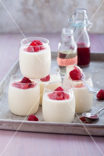 Panna cotta with elderflower syrup and raspberries