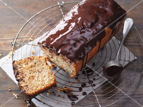 Nut cake with chocolate glaze on a wire rack