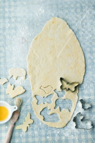Shapes being cut out of shortcrust pastry