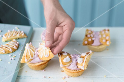 Butterfly cupcakes being decorated