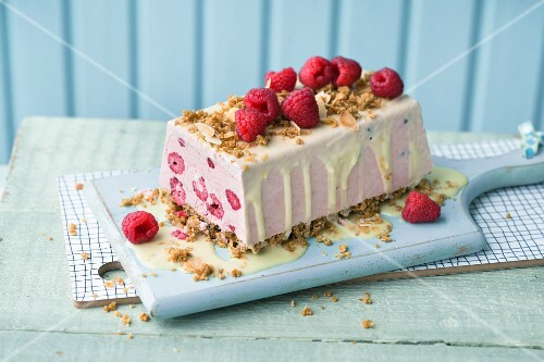 Raspberry ice cream cake with a biscuit base