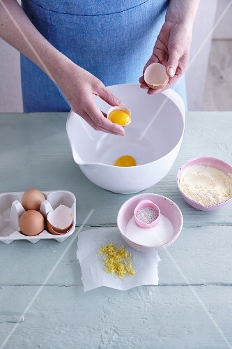 Ingredients for gluten-free sponge cake being added to a mixing bowl