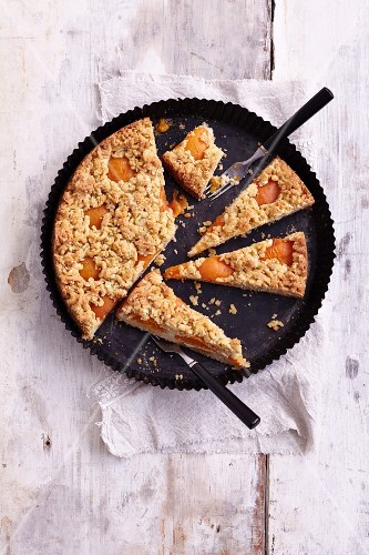 Gluten-free apricot cake with cashew nut mousse and sesame seed crumbs