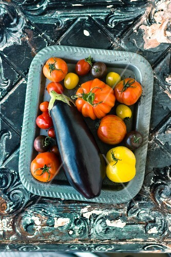 Aubergines and various different coloured tomatoes