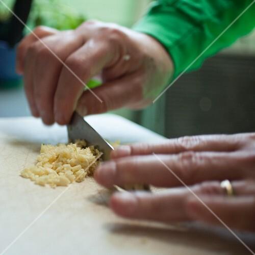 Garlic being chopped