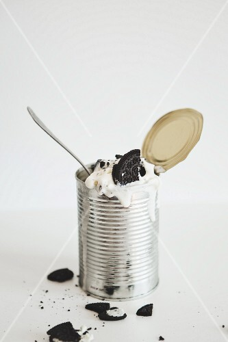 An ice cream dessert with Oreo cookies served in a tin can