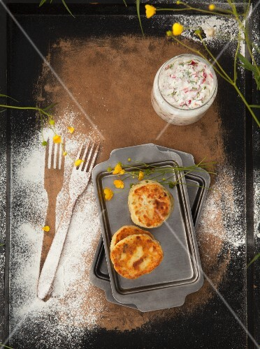 Goat's cheese pancakes with a radish dip and wild herbs