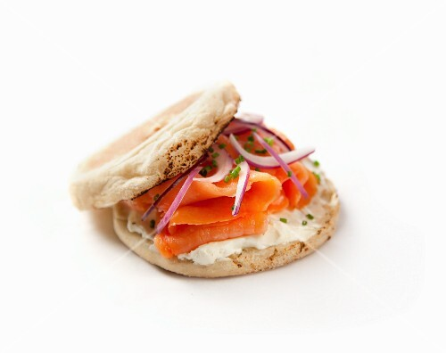 A cream cheese and smoked salmon toastie on a white surface