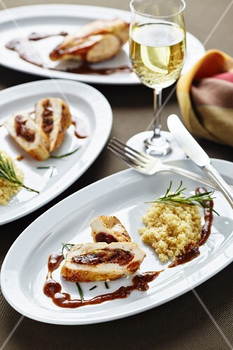Chicken breast with a dried fruit stuffing and couscous