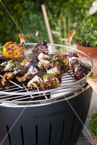 Spicy aubergine & tofu kebabs on a barbecue
