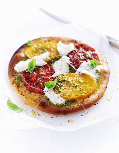 Pizza with mozzarella and beefsteak tomatoes