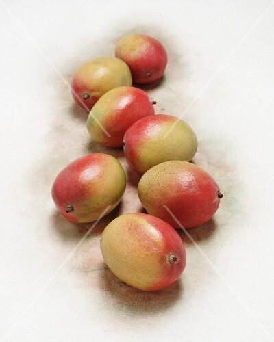 Mangos on a white surface