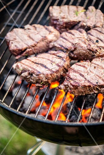 Beef fillet on a charcoal grill