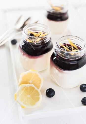 Panna cotta with blueberry coulis and lemon zest