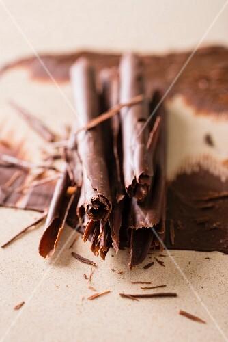 Chocolate rolls as cake decoration (close-up)