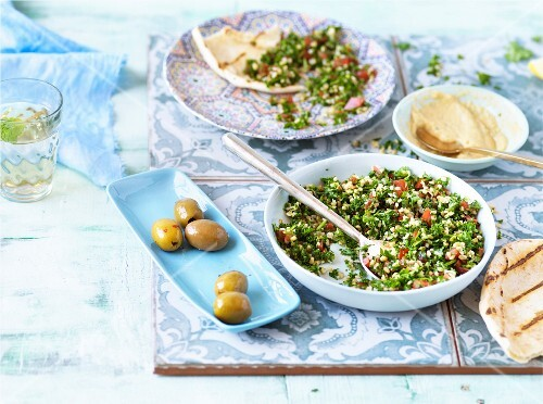 Tabbouleh, hummus, pita bread and olives