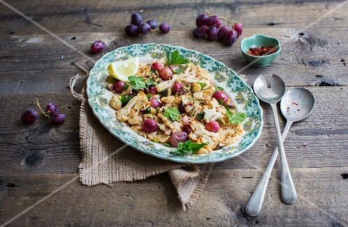 Cauliflower salad with red grapes, parsley and pul biber