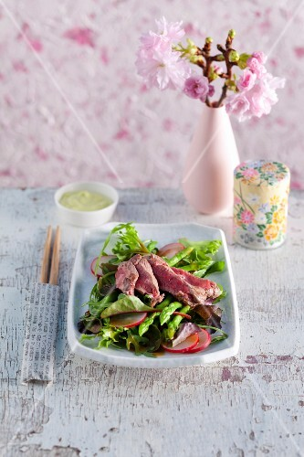 A beef steak with salad and wasabi mayonnaise