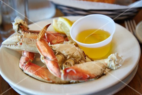 Crab legs with liquid butter in a restaurant