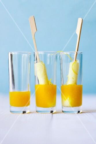 Elderflower and lemon sorbet on sticks with mango and elderflower and jus in glasses