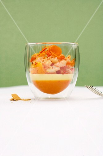 Shrimp and citrus salad with sour cream mousse and orange and chilli jelly in a glass