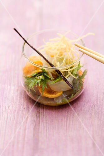 Sander marinated in vanilla with roasted melon and spiced juice in a glass