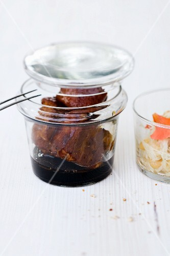 Pork belly in ginger confit with a papaya and peanut salad in a jar