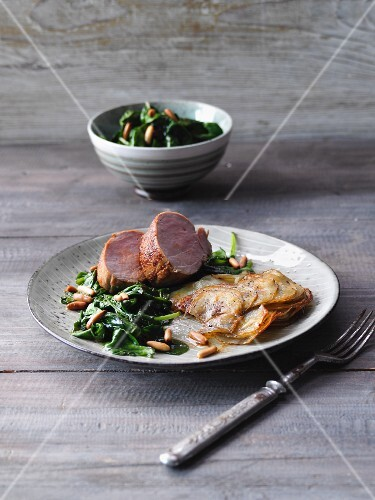 Pork tenderloin with gratinated potatoes and spinach