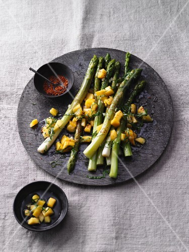 Green asparagus salad with chilli, mango and honey