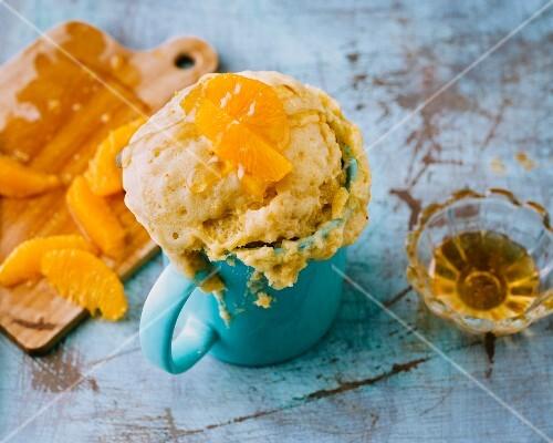 A mug cake with oranges and honey