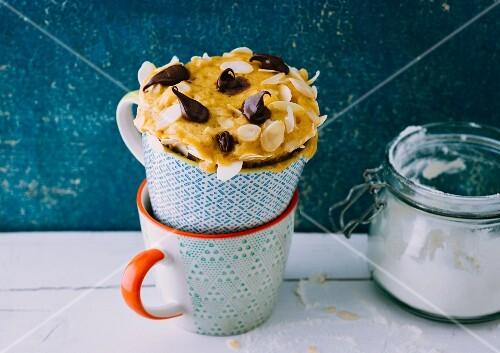 A banana boat-style mug cake with bananas and chocolate cream