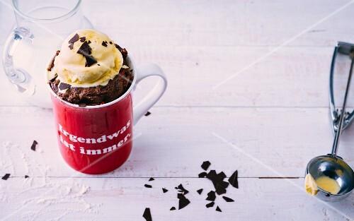 A chocolate mug cake with chilli flakes and vanilla ice cream